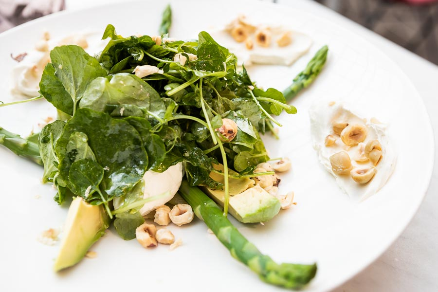 Cream cheese and yogurt salad with avocado, green asparagus and hazelnuts