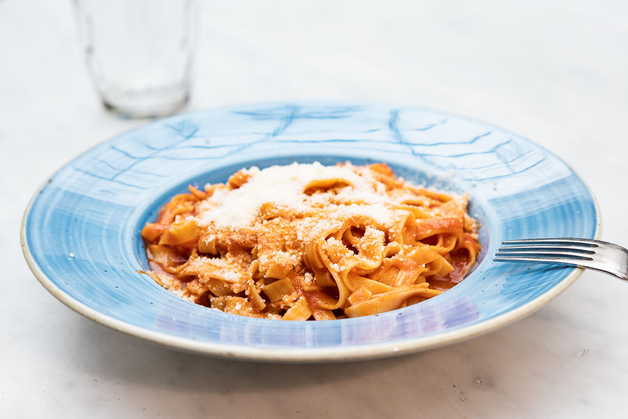 Linguini served with tomato and parmesan cheese