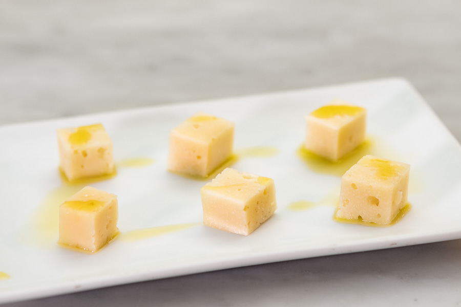 Chunks of pure mature sheep's cheese with a few drops of olive oil
