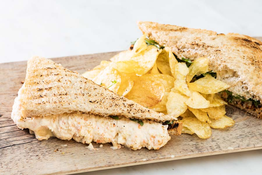 Special sandwich with potato salad and rocket