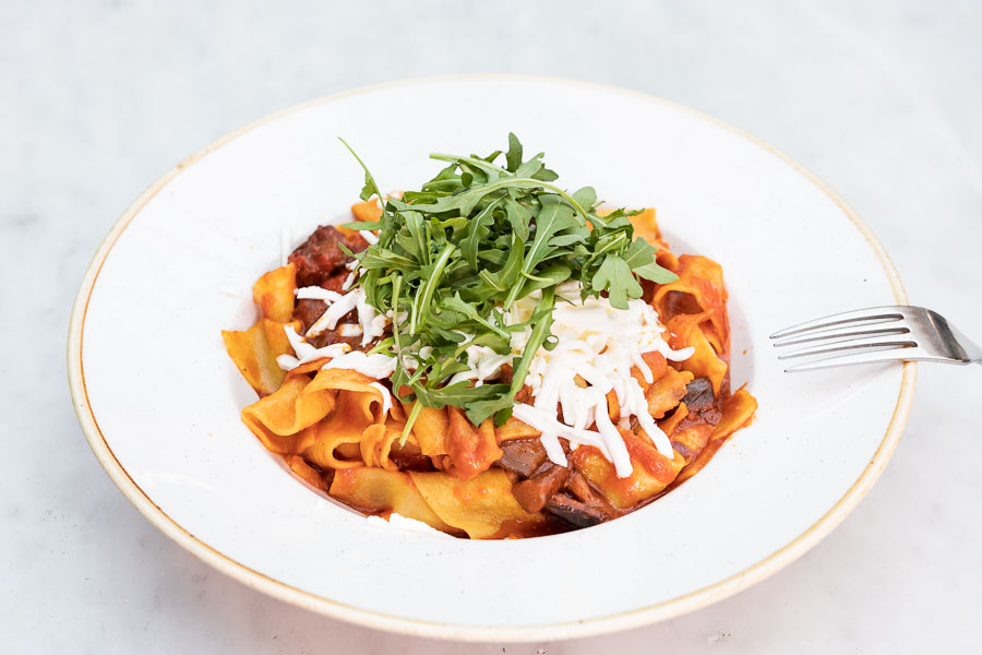 Tagliatelle noodles with tomato sauce, aubergine and fresh grated cheese