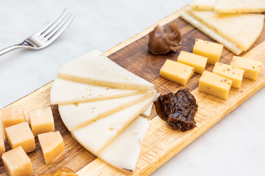 Four cheese platter with four distinct jams
