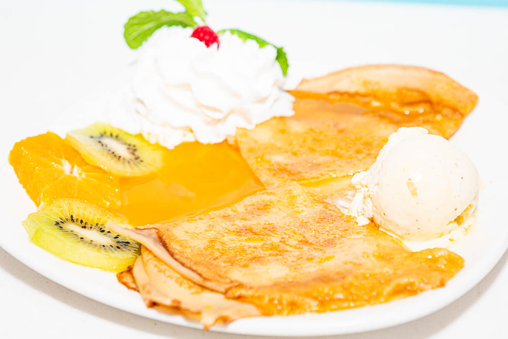 Crêpes suzette with fresh fruit and vanilla ice cream